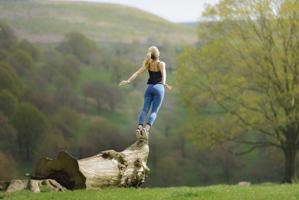 Woman on a log
